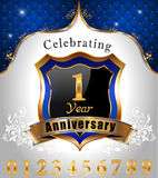 Celebrating 1 years anniversary, Golden sheild with blue royal emblem background Royalty Free Stock Image