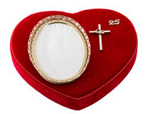 Celebrating 25 years of marriage. Red heart over white with an empty frame and a protestant cross celebrating marriage. Concept of love, union of a religious Stock Images