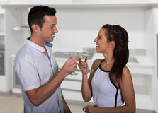 Celebrating Young Couple inside their House Stock Photo