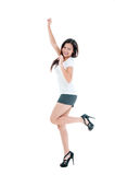 Celebrating Young Woman Jumping Stock Photos