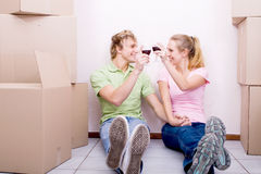Celebration. Young happy couple doing celebration for moving to their first home Royalty Free Stock Photo