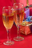 Celebration. Two glasses with wine  and gifts Stock Images