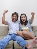 Celebration. Couple watch a movie at home with popcorn Stock Images