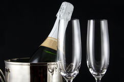 Celebration. Close-up of champagne bottle in ice bucket with two glass flutes stock image