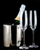Celebration. Champagne bottle in ice bucket with two glass flutes stock photography