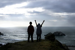 Celebration. Little boys celebrate at top of rock Royalty Free Stock Images