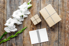 Celebration accessories. Boxes in kraft paper on wooden table top view stock photography
