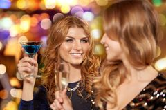 Happy women drinks in glasses at night club. Celebration, bachelorette party and holidays concept - happy women or female friends with non-alcoholic drinks in royalty free stock photo