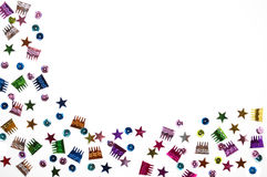 Celebration Background. Colorful sequins shapes of stars, birthday catkes, and circles scattered on white background Royalty Free Stock Image