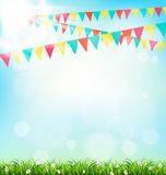 Celebration background with buntings grass and sunlight on sky. Background Stock Photo