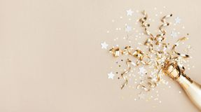 Celebration Background With Golden Champagne Bottle, Confetti Stars And Party Streamers. Christmas, Birthday Or Wedding. Flat Lay Stock Photos
