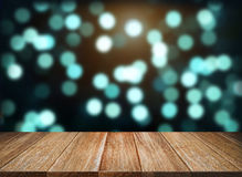 Celebration background of Wood table on blue light bokeh royalty free stock photo