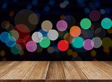 Celebration background of Wood table on colorful light bokeh stock photo