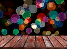 Celebration background of Wood table top on colorful bokeh stock photo