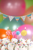 Celebration with Balloons Candles and Cake Royalty Free Stock Photos