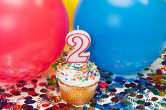 Celebration with Balloons, Confetti, and Cupcake Royalty Free Stock Photography
