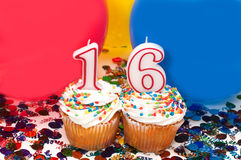 Celebration with Balloons, Confetti, and Cupcake. Celebration with balloons, confetti, cupcake, and number 16 candle Royalty Free Stock Images