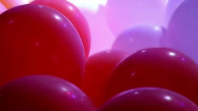 Celebration balloons and flashing lights stock footage