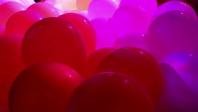 Celebration balloons and flashing lights stock video