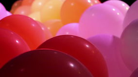 Celebration balloons and flashing lights stock video footage
