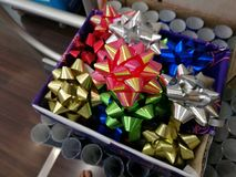 Celebration the boxing day with closed up  variety colorful ribbon collection with blur boken gift wrapping paper roll b Royalty Free Stock Images