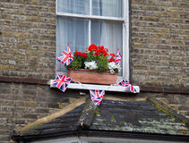 Celebration Bunting for Diamond Jubille. London house decorated with celebration red, white and blue flowers and Union Flag bunting to mark the Diamond Jubilee Stock Photography