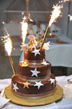 Celebration Cake. Big brown birthday celebration cake with fireworks on it Stock Photos