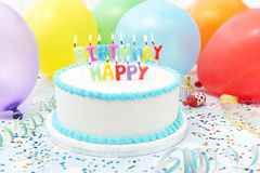 Celebration Cake With Candles Spelling Happy Birthday Royalty Free Stock Photography