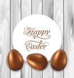 Celebration card with Easter chocolate eggs on wooden grey backg Stock Photo