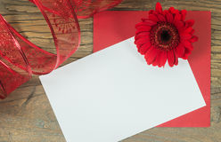 Celebration card with Gerbera flower and empty note Royalty Free Stock Photo