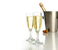 Celebration with champagne. Champagne flutes and ice bucket, festive combo Royalty Free Stock Photos