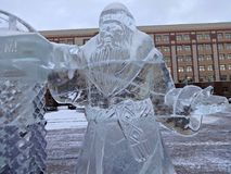 Ice sculpture Santa Claus in a winter city Royalty Free Stock Photo