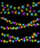 Celebration Christmas New Years Birthdays and other events glowing colorful led lights bulbs lamps, circles and stars. Hanging garland background Royalty Free Stock Photography