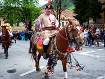 Celebration in the city of Brasov 6. Celebration of Brasov city days and Juni parade. Horseman on parade. Old romanian habit. Traditional celebration in Easter Royalty Free Stock Photos
