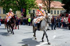 Celebration in the city of Brasov 8. Celebration of Brasov city days and Juni parade. Horseman on parade. Old romanian habit. Traditional celebration in Easter Stock Photography