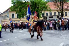 Celebration in the city of Brasov 11. Celebration of Brasov city days and Juni parade. Horseman on parade. Old romanian habit. Traditional celebration in Easter stock photo