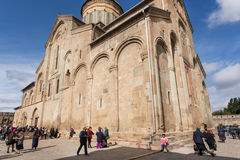 Celebration of City Day in crowd near the historical christian Svetitskhoveli Cathedral, UNESCO World Heritage Site. Royalty Free Stock Image