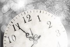 Celebration concept. Conceptual image of clock with bokeh lights and firework Royalty Free Stock Photography