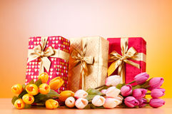 Celebration concept - gift box and tulips Royalty Free Stock Images