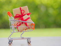 Celebration concept. Many New Year and Christmas presents or gifts represented in shopping cart Royalty Free Stock Images