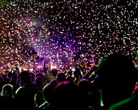 Confetti over crowd. Confetti falling over head of crowd at concert or celebration Royalty Free Stock Photo
