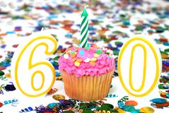 Celebration Cupcake with Candle - Number 60 Stock Photo