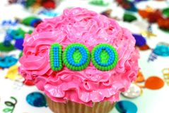 Celebration Cupcake - Number 100. Number 100 celebration cupcake with confetti Royalty Free Stock Photo