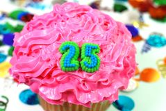 Celebration Cupcake - Number 25. Number 25 celebration cupcake with confetti Royalty Free Stock Image