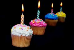Celebration Cupcakes with Lit Candles Royalty Free Stock Photography