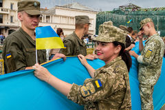 Celebration of the Day of the State Flag of Ukraine in Uzhgorod. Uzhgorod, Ukraine - August 23, 2017: The soldiers fold the 100-meter flag during the celebration royalty free stock photos