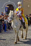 Man and child on the horse, in traditional national costumes at the parade - Celebration Days of Brasov City, landmark in Romania. Man and child on the horse, in royalty free stock photo