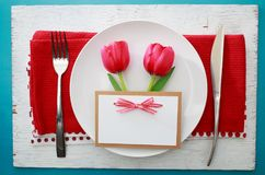Celebration dinner theme. With greeting card and dinner plate Royalty Free Stock Photo