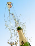 Celebration with drink champagne bubbles. A Quark poping off of the champaign bottle with lots of splash Royalty Free Stock Photography