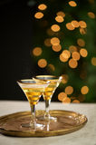 Celebration Drinks with Lights. Two vintage glasses with sparkling drink and lights Stock Photography